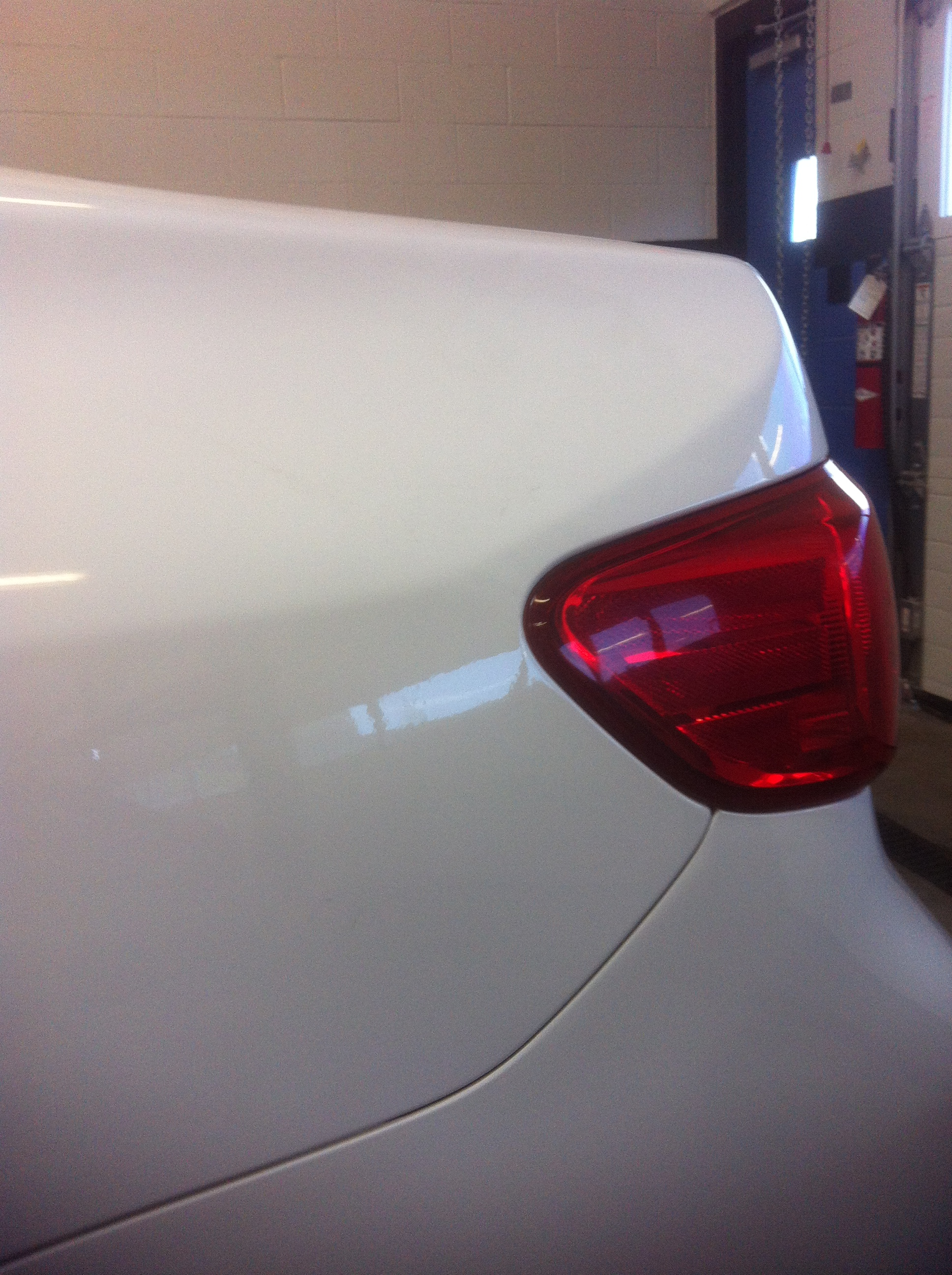 White Corolla Quarter Dent After