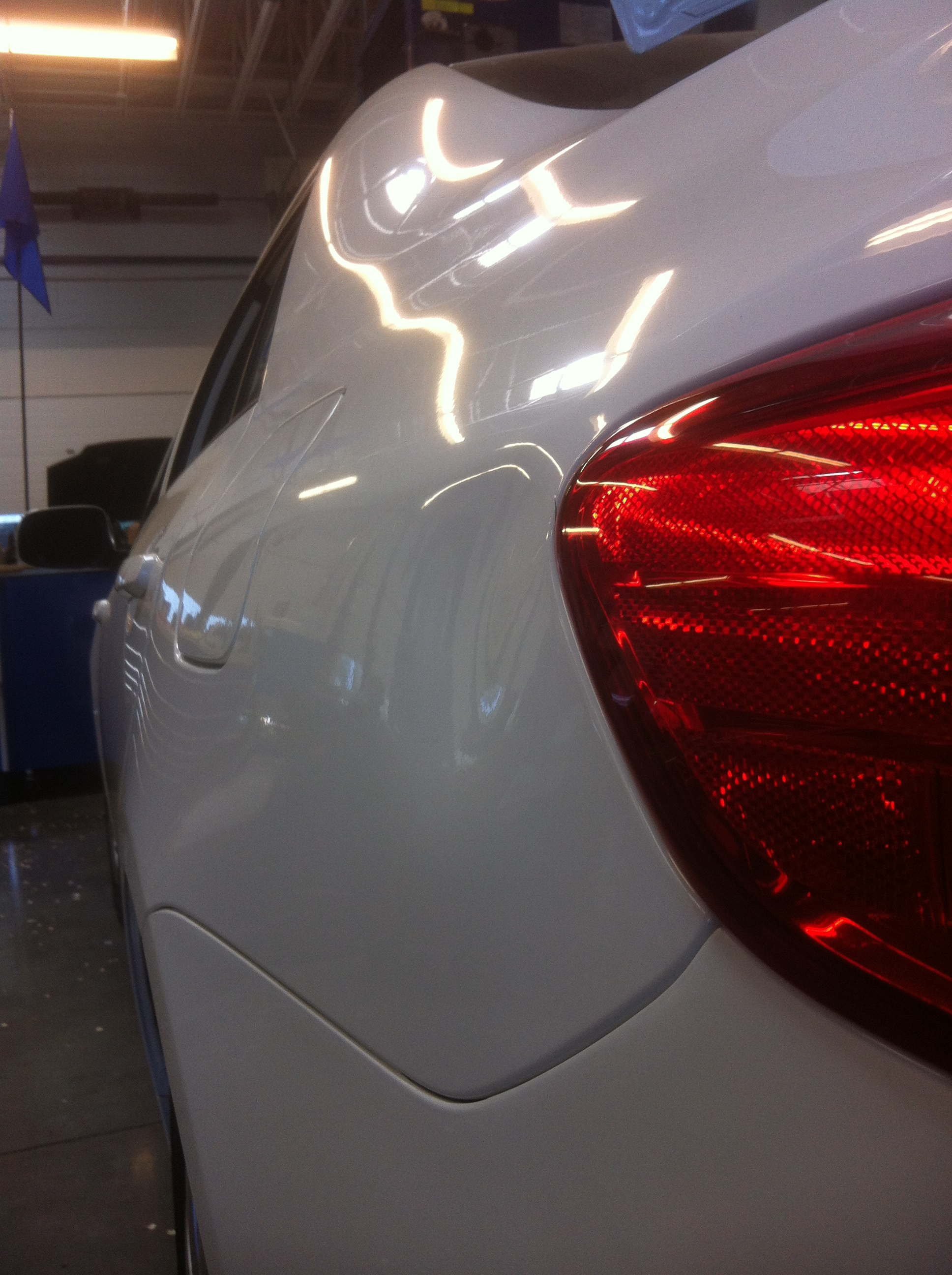 White Corolla Quarter Dent Before 2